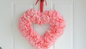 Coffee filters shaped like carnations make up this adorable heart wreath; perfect for Valentine's Day!