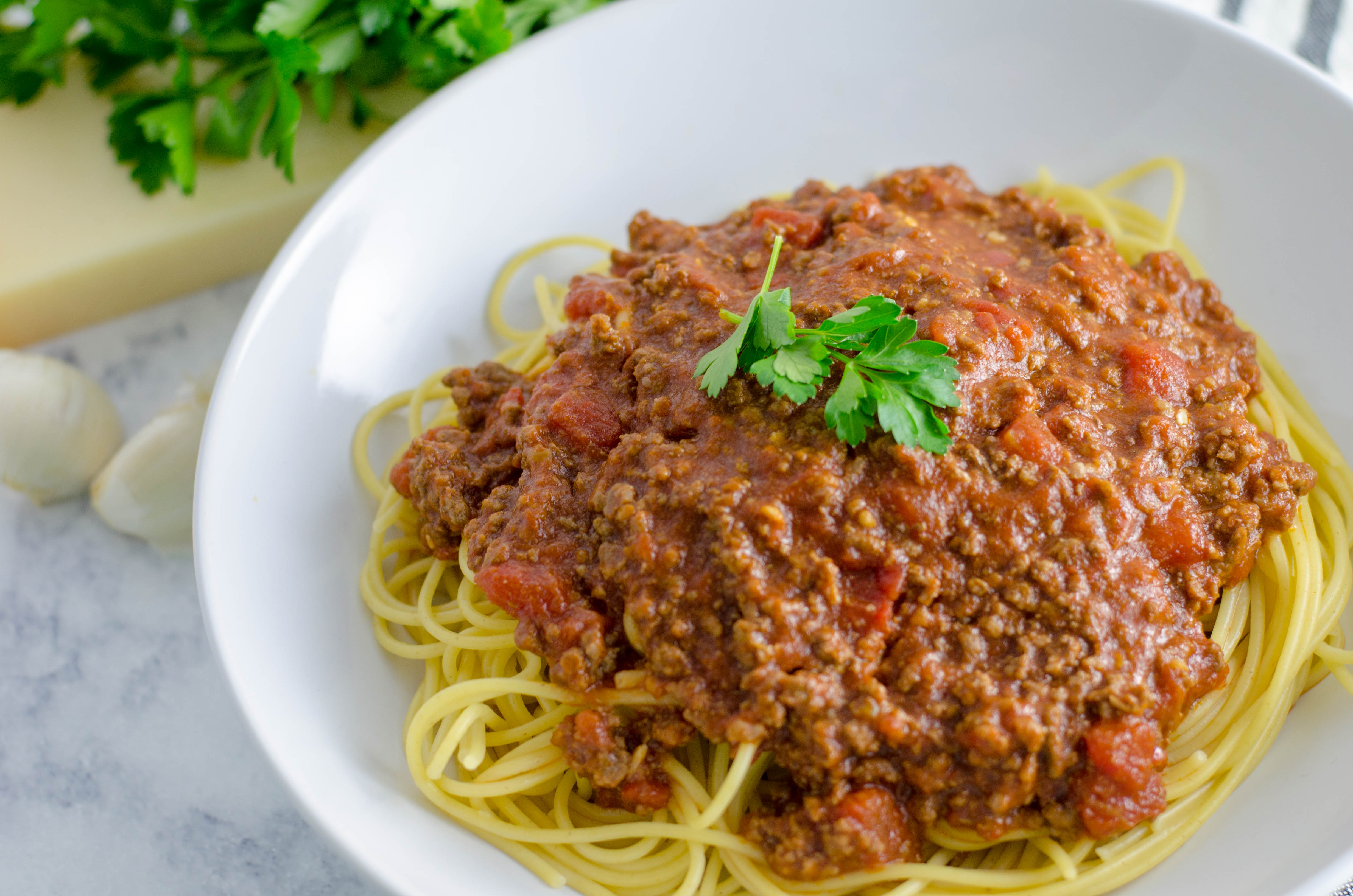 The ultimate comfort food. Simple, delicious and super easy to make, this spaghetti with meat sauce will be sure to impress at dinner tonight.